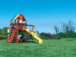 Kids playing on a Fiesta Clubhouse style swing set
