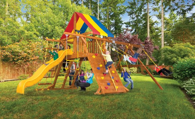 Rainbow swing set in back yard