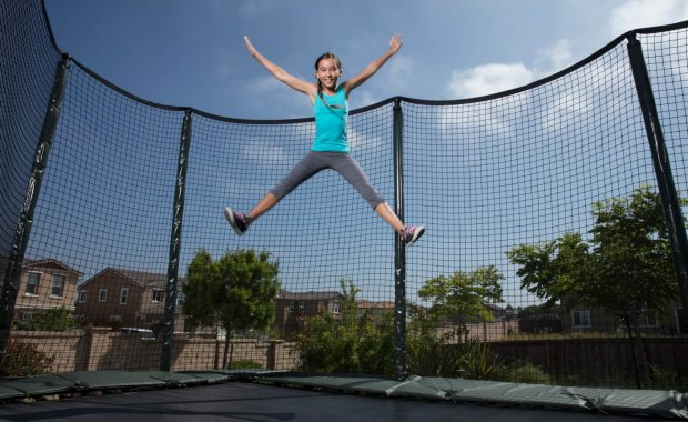 Jumping high on AlleyOOP trampoline with net