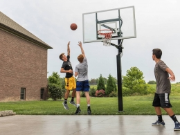 Kids playing basketball outdoors