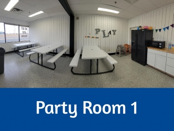 Indoor Party Room #1 with wooden picnic tables and white walls