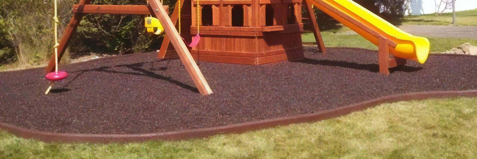 Rubber mulch under swing set