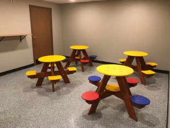 Indoor party room with colorful seating
