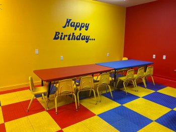 Colorful Indoor Party Room with yellow, red, and blue decor