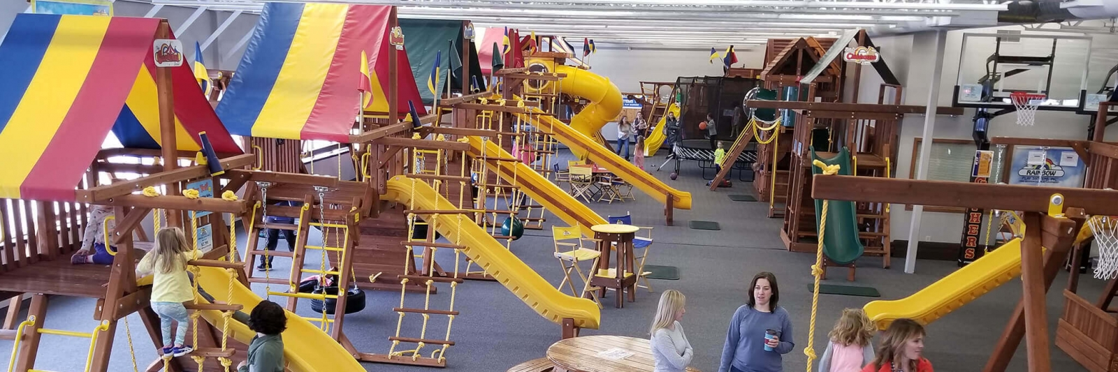 Variety of play sets displayed at indoor playground showroom